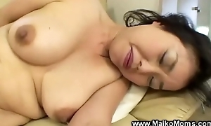Japanese milf uses fake strapon in the forefront to giving bj