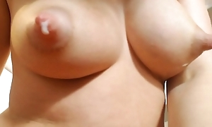Young female parent shows her big natural milky tits